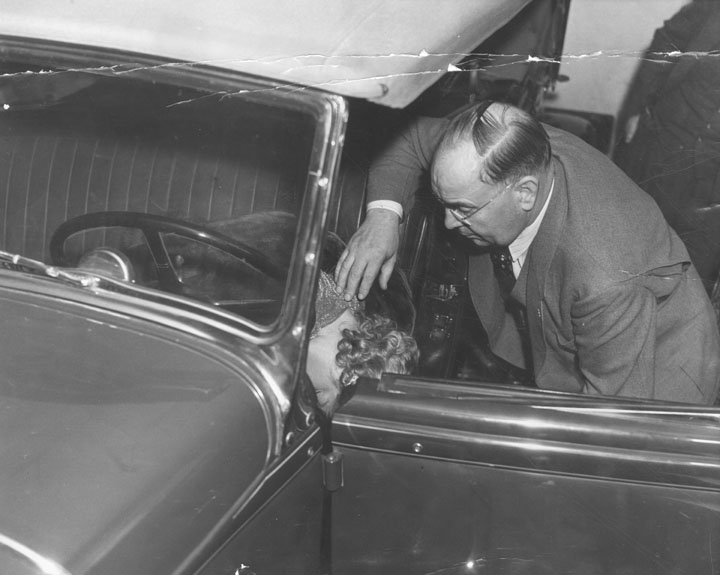 Captain Bert Wallis of the police homicide squad checks position of Thelma Todd's body. The coroner's report said her death was caused by carbon monoxide poisoning, but doubt remained.jpg