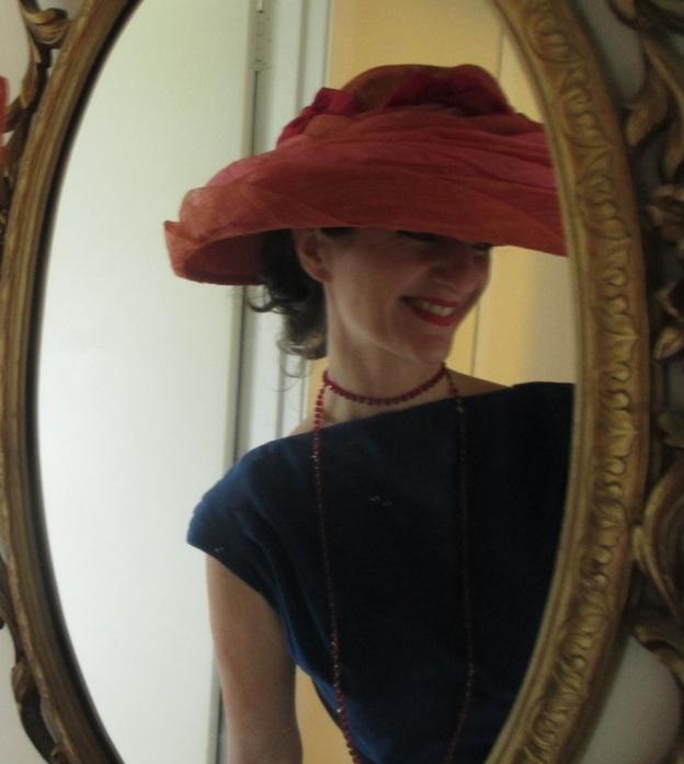 Vogue jump suit hat in mirror.jpg