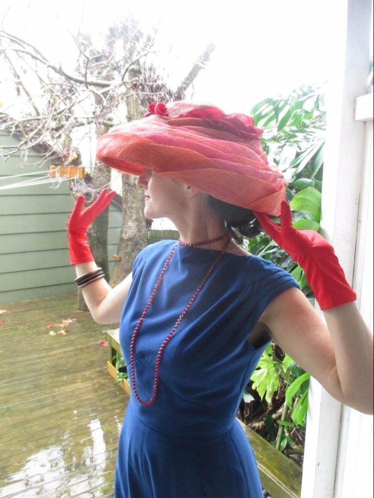 vogue-jump-suit-mash-up-big-red-hat-and-gloves.jpg